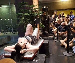 Erica Furness lies on a bed of nails